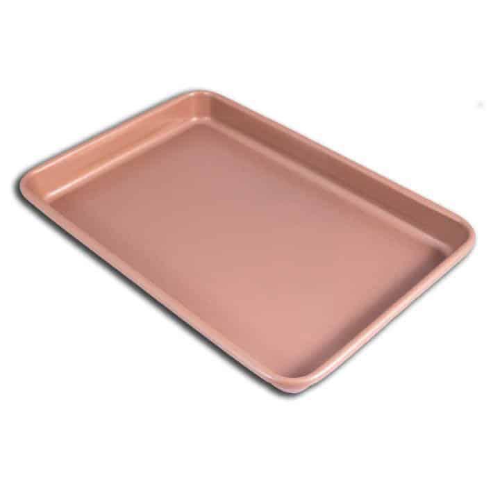 Large rose gold baking tray on white background