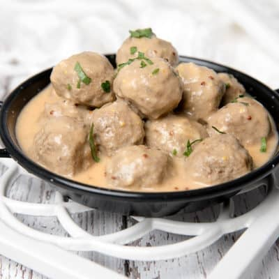 Square image Swedish Meatballs on white background