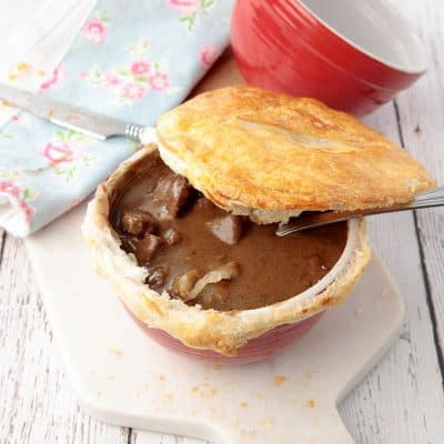 Homemade Guinness Pot Pie with pastry lifted to reveal the filling