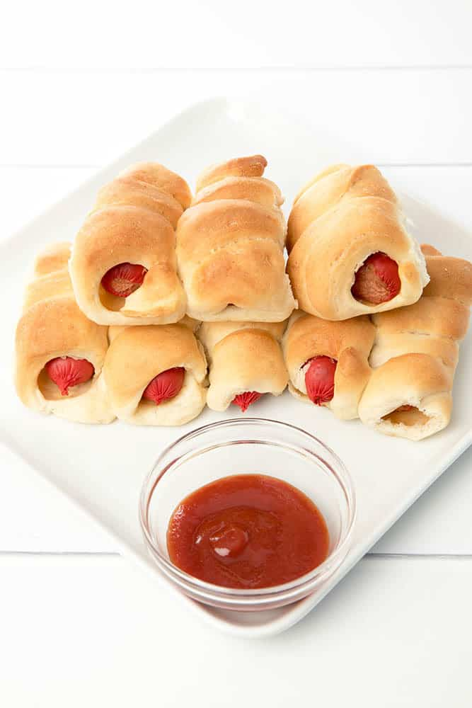 Stuck for a lunchbox idea the kids will love???  Pigs in Blankets or mini hot dogs are a fabulous lunch box idea for kids! Best of all they're super quick to make in the Thermomix!  Kid friendly recipe made even quicker with the Thermomix.