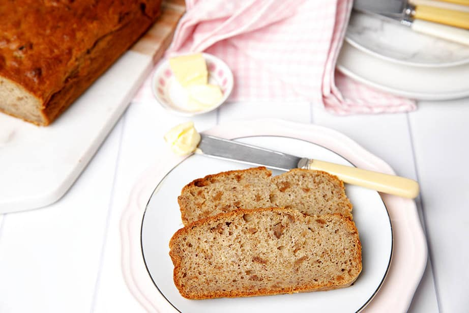 Healthy sugar free Banana Bread on a plate with butter