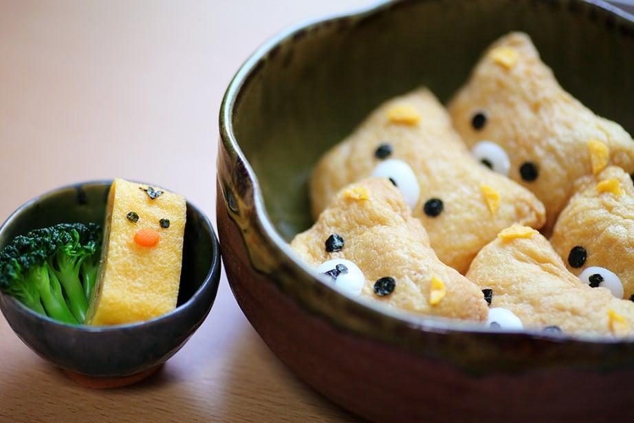 Inari Sushi made into the panda shape in a bento box