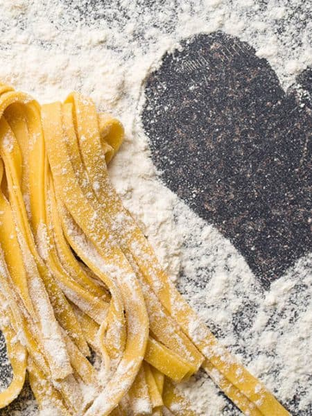 Square image of pasta on a black bench