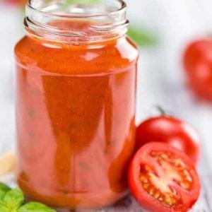 Napoletana Sauce in a glass jar white background
