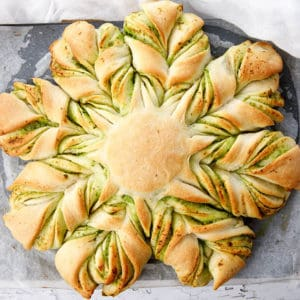 Overhead shot of cheese garlic bread shaped into a braided star