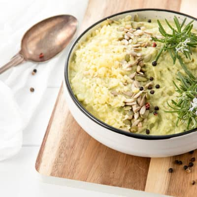 Loaded Mashed Cauliflour Thermomix recipe in a white bowl with a retro spoon