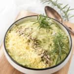 Square Image mashed cauliflower topped with herbs, nuts and cheese
