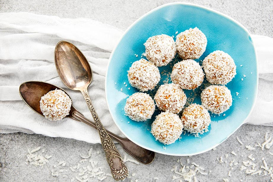 Overhead landscape image Carrot Cake Protein balls on blue plate