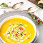 Overhead portrait image of Thai Pumpkin Soup in a white bowl