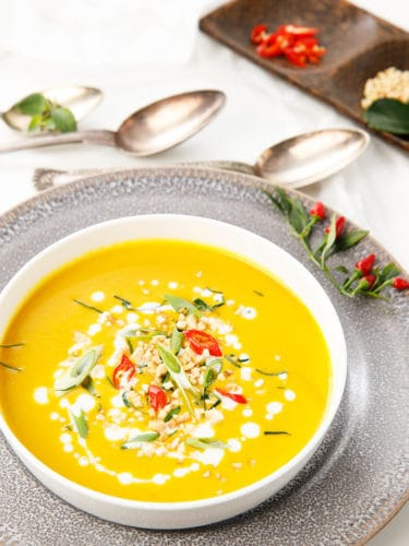 Overhead portrait image of Thai Pumpkin Soup in a white bowl