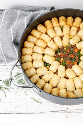 Profile picture Thermomix Shepherds Pie with potato gems in a round backing dish on white background