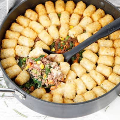 Thermomix Shepherds Pie with potato gems in a round backing dish