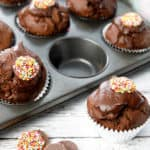 Close up double chocolate muffin on white wood background