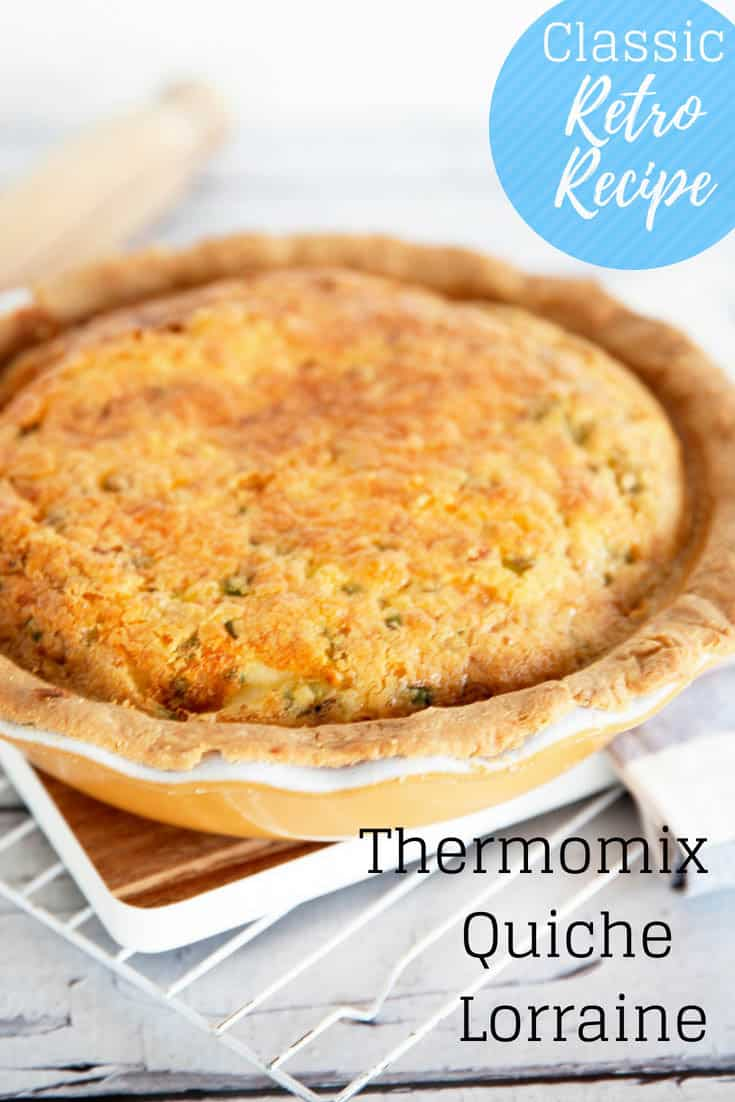 Whole Quiche Lorraine image with title on a chopping board
