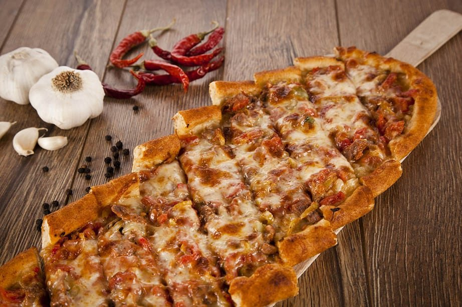 Overhead shot of Turkish Pide on a wooden board