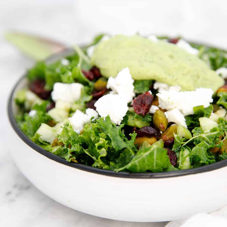 Square image of kale salad with avocado dressing