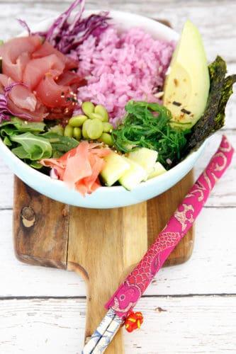 Overhead shot of tuna poke bowlon wooden chopping board