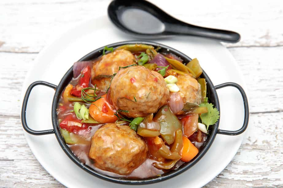 Overhead shot of pork meatballs in a sweet and sour sauce