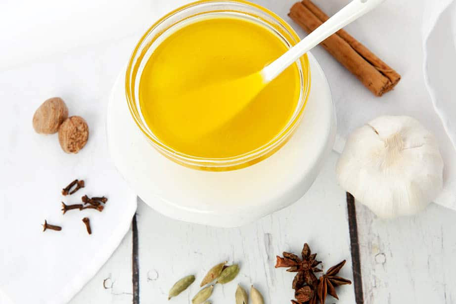 Clarified butter made into an Indian spiced ghee on a white background