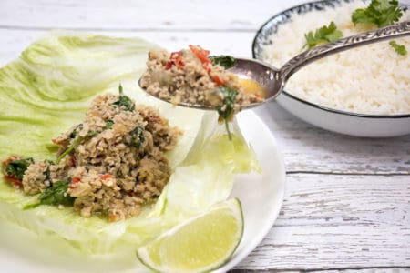 Chicken Larb being spooned into lettuce cups