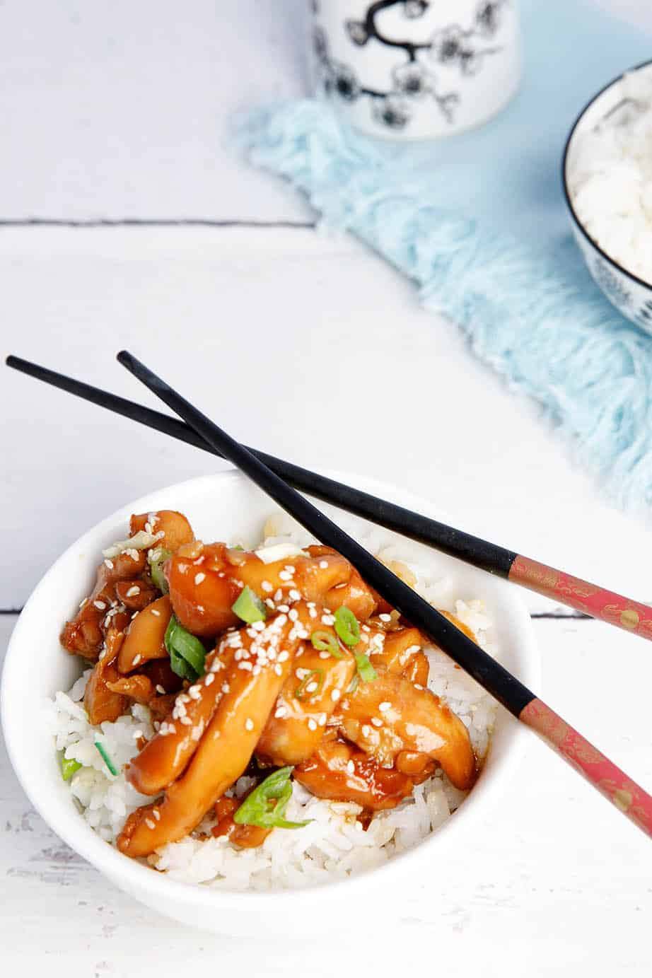 Overhead shot Chicken teriyaki on rice with chopsticks