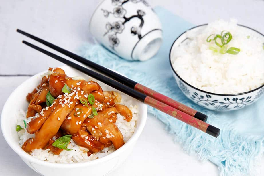 Teriyaki Chicken on a white background with rice and chopsticks
