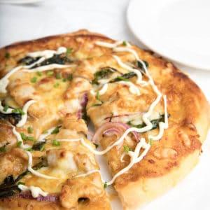 Homemade Buffalo Chicken pizza on white table