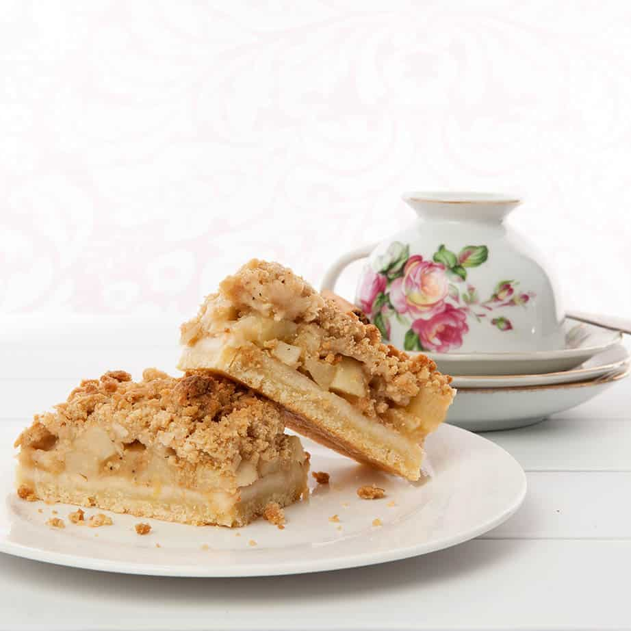 Square image of apple streusel on a white background