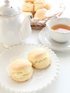 Scones on white crockery and white background