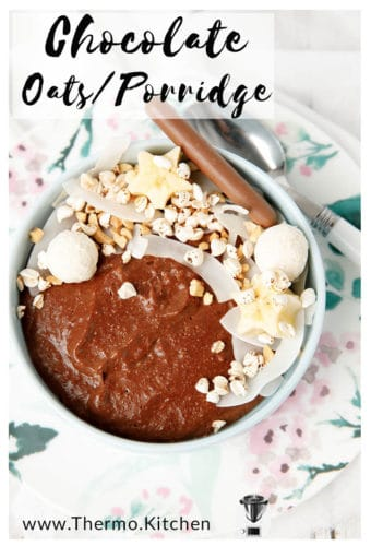 Image of chocolate oatmeal in a bowl topped with banana wheat puffs and coconut, with a title for pinterest