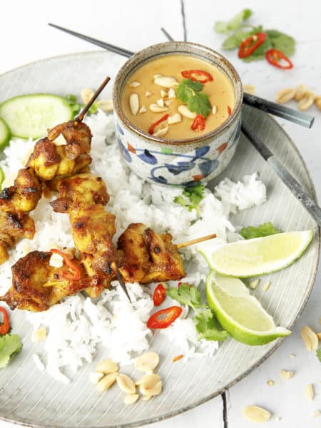 Overhead image of Malaysian Chicken Skewers on rice