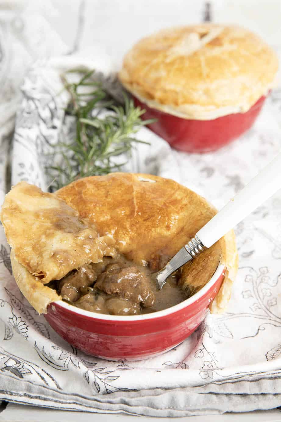 Two Peppercorn pot pies one with the pastry removed