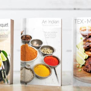 Three Thermomix cookbooks on a shelf