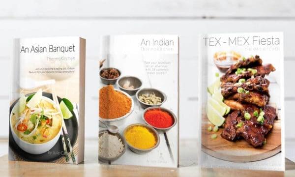 Three Thermomix cookbooks on a shelf
