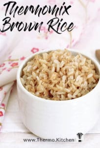 Titled pinterest image Cooked brown rice in a white bowl wooden spoon and floral serviette