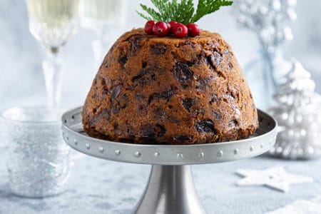 Traditional Thermomix Christmas pudding on a light Christmas background