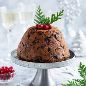 portrait image of steamed Thermomix Christmas pudding on light background.