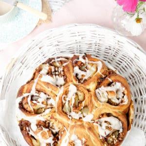 Portrait image sticky buns in white basket, overhead shot