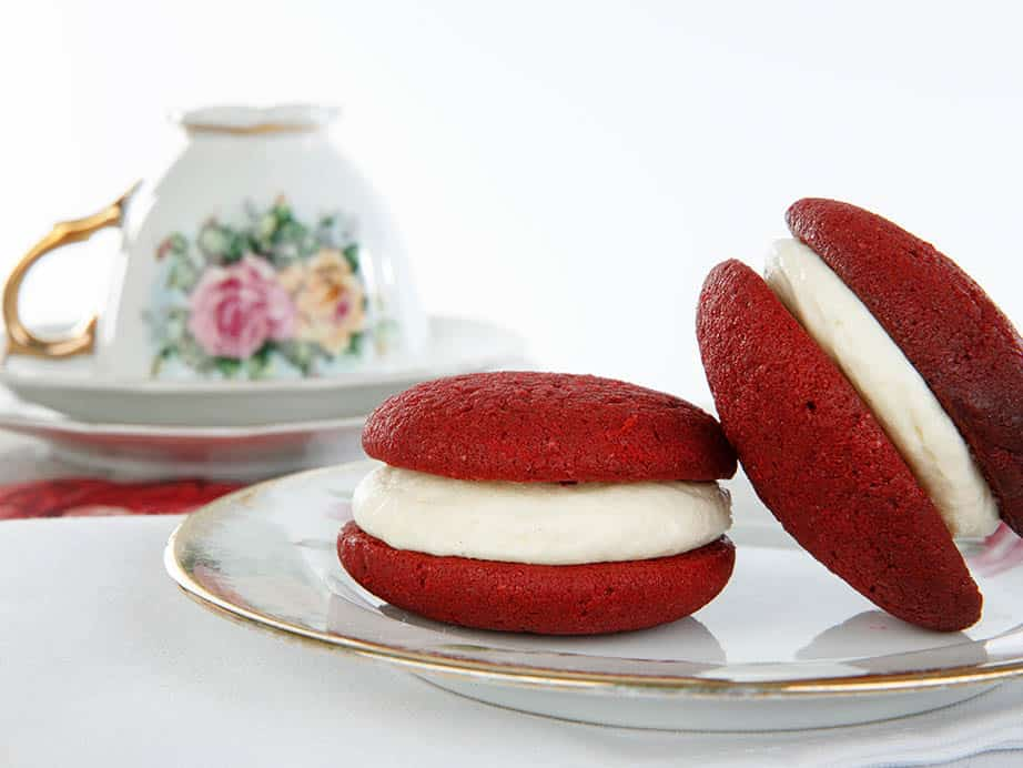 Landscape close up of red velvet whoopie pies on white background