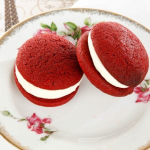 Red Velvet Whoopie pie on a floral cake plate