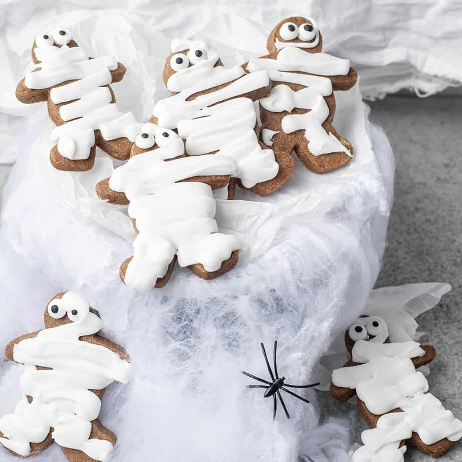 Spooky mummy cookies on a white background with spiders