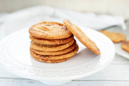 Caramilk Snickerdoodle Cookies in a stack on a white platter