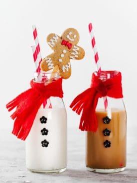 Image of milk bottles dress as Santa for Christmas