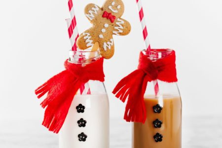 Image of milk bottles dress as Santa for Christmas
