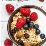 Natural Yoghurt in a bowl with berries and granola, white background