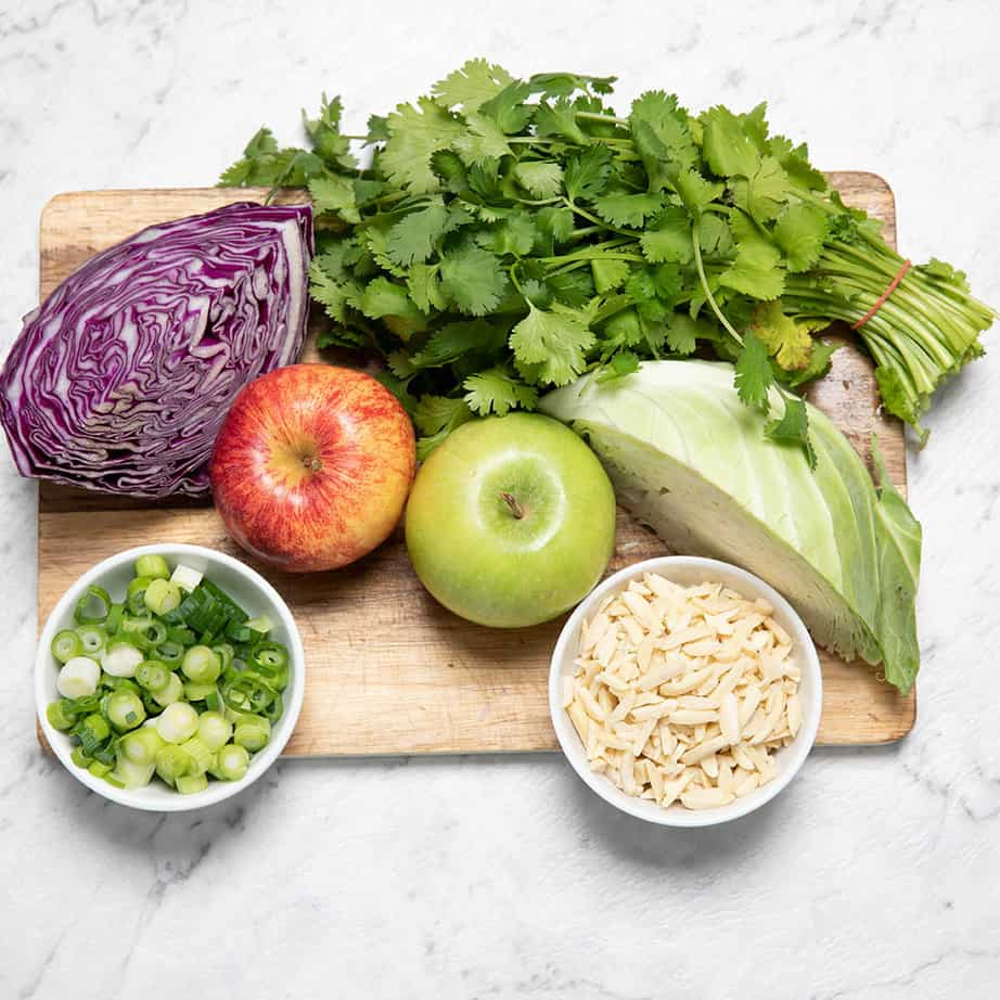 Chopping board showing the ingredients for Thermomix Coleslaw.