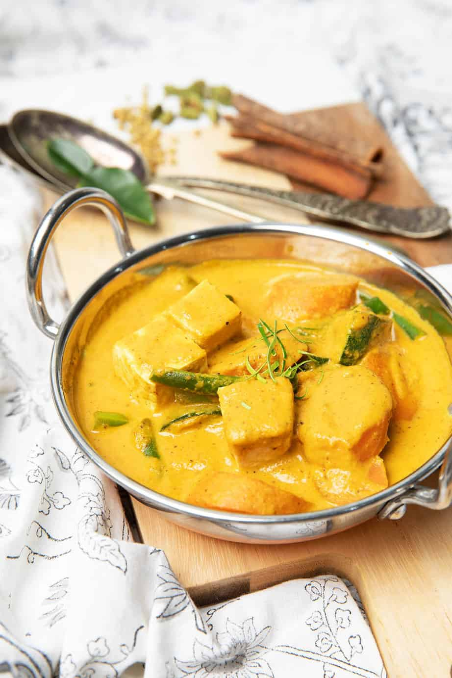 Portrait image vegetarian curry in a metal bowl.